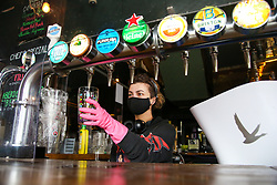 © Licensed to London News Pictures. 08/04/2021. London, UK. A member of staff tests the beer dispenser at The Finsbury Pub in Finsbury Park, north London, as pubs with beer gardens prepare to re-open on Monday 12 April, following the easing of Covid-19 lockdown restrictions. Photo credit: Dinendra Haria/LNP