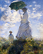 Claude Monet (14 November 1840 – 5 December 1926) French impressionist painter. The term Impressionism is derived from the title of his painting Impression, Sunrise (Impression, soleil levant). 'Woman with a Parasol, (Camille and Jean Monet)', 1875, National Gallery of Art, Washington, DC.