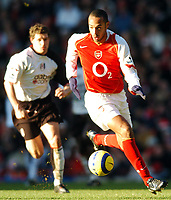 Photo: Javier Garcia/Back Page Images<br />Arsenal v Fulham, FA Barclays Premiership, Highbury, 26/12/04<br />Thierry Henry skips away from Moritz Volz