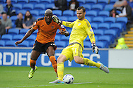 David Marshall, the Cardiff city goalkeeper clears as Benik Afobe of Wolverhampton Wanderers closes in. Skybet football league championship match, Cardiff city v Wolverhampton Wanderers at the Cardiff city stadium in Cardiff, South Wales on Saturday 22nd August 2015.<br /> pic by Andrew Orchard, Andrew Orchard sports photography.