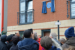 Leyton Orient fans take pictures with mobile phones of a blue plaque on Brisbane Road in memory of the late Laurie Cunningham - Photo mandatory by-line: Mitchell Gunn/JMP - Tel: Mobile: 07966 386802 12/10/2013 - SPORT - FOOTBALL - Brisbane Road - Leyton - Leyton Orient V MK Dons - League One