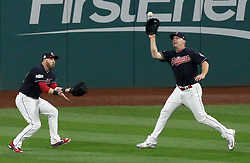 October 6, 2017 - Cleveland, OH, USA - Cleveland Indians center fielder Jason Kipnis, left, backs up right fielder Jay Bruce as he snags a line drive off the bat of the New York Yankees' Aaron Hicks in the eighth inning during Game 2 of the American League Division Series, Friday, Oct. 6, 2017, at Progressive Field in Cleveland. (Credit Image: © Mike Cardew/TNS via ZUMA Wire)