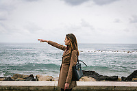 SANTA MARIA DI CASTELLABATE (CASTELLABATE), ITALY - 14 FEBRUARY 2018: Alessia d'Alessandro (28), the Five Stars Movement (M5S, Movimento 5 Stelle) candidate running for the Chamber of Deptuies in the 2018 Italian General Elections, points out a beach of Santa Maria di Castellabate, where she spent her weekends and summers between the age of 14 and 18, on February 14th 2018.<br /> <br /> Santa Marina di Castellabate is part of the electoral college of Agropoli, in the Campania region (southern Italy) in which Franco Alfieri (Democratic Party, PD, Partito Democratico), politically active for the past 30 years, is running agains the 28-years old Alessia d'Alessandro (Five Stars Movement, M5S, Movimento 5 Stelle).<br /> <br /> The 2018 Italian general election is due to be held on 4 March 2018 after the Italian Parliament was dissolved by President Sergio Mattarella on 28 December 2017.<br /> Voters will elect the 630 members of the Chamber of Deputies and the 315 elective members of the Senate of the Republic for the 18th legislature of the Republic of Italy, since 1948.Santa<br /> <br /> The 2018 Italian general election is due to be held on 4 March 2018 after the Italian Parliament was dissolved by President Sergio Mattarella on 28 December 2017.<br /> Voters will elect the 630 members of the Chamber of Deputies and the 315 elective members of the Senate of the Republic for the 18th legislature of the Republic of Italy, since 1948.