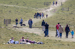 Licensed to London News Pictures. 18/04/2021. London, UK. Members of the public soak up the sunshine in Richmond Park South West London as they picnic on the first weekend of the easing of Covid-19 restrictions. Shops, pubs, bars and restaurants are now serving customers for the first time in over 4 months as a mini heatwave is set to hit the UK this week with temperatures predicted to reach up to 18c in London and the South East. Photo credit: Alex Lentati/LNP