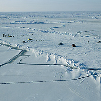 Expedition camp at North Pole, surrounded by open water leads.