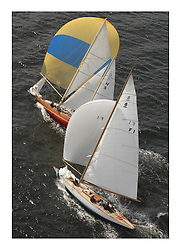 Sailing -Day 3 racing at the 8 metre World Championship 2007 held on the Clyde at The Royal Northern & Clyde YC as part of it's Centennial year..Aerial of F1 Aile VI and First Rule boat Elfe II H9 downwind..