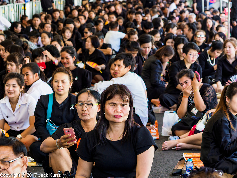27 SEPTEMBER 2017 - BANGKOK, THAILAND: People in line to get into the Grand Palace. The Royal Household has announced that the palace will close to the public, including tourists, on 04 October 2017 to allow officials to complete preparations for the cremation of Bhumibol Adulyadej, the King of Thailand, who died on 13 October 2016. They also extended the official mourning period by 15 days. It was originally set to end on 13 October 2017 but now will end on 26 October 2017, the day of the King's cremation.    PHOTO BY JACK KURTZ