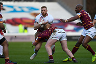 Joe Bullock (19) of Wigan Warriors on the attack during the Betfred Super League match between Huddersfield Giants and Wigan Warriors at the John Smiths Stadium, Huddersfield, England on 1 March 2020.