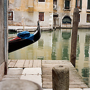 A Gondola tied up in the canal ways of Venice near Piazza San Marco. Venice, Italy. 1st May 2011. Photo Tim Clayton