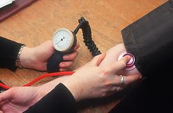 Patient having blood pressure taken,