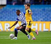 Lincoln City's Chris Maguire vies for possession with Sheffield Wednesday's Dennis Adeniran<br /> <br /> Photographer Andrew Vaughan/CameraSport<br /> <br /> The EFL Sky Bet League One - Sheffield Wednesday v Lincoln City - Saturday 23rd October 2021 - Hillsborough Stadium - Sheffield<br /> <br /> World Copyright © 2021 CameraSport. All rights reserved. 43 Linden Ave. Countesthorpe. Leicester. England. LE8 5PG - Tel: +44 (0) 116 277 4147 - admin@camerasport.com - www.camerasport.com