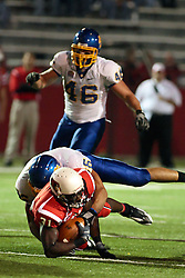 26 September 2009: Clifton Gordon gets taken down while sprinting through the line in a game which the South Dakota State Jackrabitts jump past the Illinois State Redbirds 38 - 17 at Hancock Stadium on campus of Illinois State University in Normal Illinois