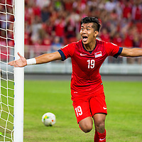 Khairul Amri (#19) of Singapore reacts after a goal against Thailand during the group stage match of the AFF Suzuki Cup at the National Stadium at the Singapore Sports Hub on November 23, 2014, in Singapore.