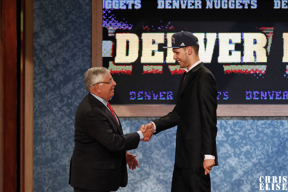 28 June 2012: French player Evan Fournier, picked up by the Denver Nuggets, is seen with David Stern during the 2012 NBA Draft, at the Prudential Center, Newark, New Jersey.