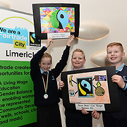 05/03/2019<br /> Winners of Fairtrade Poster competition announced.<br /> Pictured is Fairtrade poster competition winners Ciara Looby, 4th class, along with Cian Enright and Ronan Power, 5th class, all from Knockea NS.<br /> <br /> Fairtrade worker Sara Montoya, from a Fairtrade Coffee Co-op in Colombia was the special guest in Limerick City and County Council chamber today at an event to coincide with Fairtrade Fortnight.<br />  <br /> Sara joined Fairtrade supporters from across Limerick and Ireland for the annual initiative, which features a programme of talks and community events aimed at promoting awareness of Fairtrade and Fairtrade-certified products.<br />  <br /> Speaking at the event in Dooradoyle, Sara outlined the success and benefits of the Fairtrade movement in Colombia and how important it is for people in the developed world think of Fairtrade products when shopping.<br />  <br /> This year's campaign 'Create Fairtrade' invites us all to use our imagination and create fairtrade in our lives.<br />  <br /> Young people from across Limerick city and county were also a focus of the event as they displayed their posters, which they created to help change the way people think about trade and the products on our shelves.<br /> Photo by Diarmuid Greene