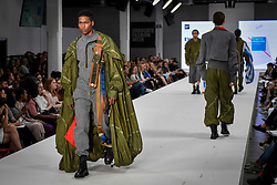 © Licensed to London News Pictures. 06/06/2018. LONDON, UK.  A model presents a look by Enki Allan from Kingston University at the Best of Graduate Fashion Week 2018 show at the Old Truman Brewery in East London. The event presents the graduation show of up and coming fashion designers from UK and international universities.  Photo credit: Stephen Chung/LNP