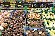 Vegetables on display at the Auchan hypermarket, outside Warsaw, Poland. The huge new supermarket, ten minutes' drive from the Sobczynsky home in Konstancin-Jeziorna, Poland, is near a big intersection that serves four or five other bedroom communities. (Supporting image from the project Hungry Planet: What the World Eats.)