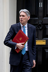 © Licensed to London News Pictures. 13/03/2019. London, UK. The Chancellor of The Exchequer Philip Hammond leaves 11 Downing Street as he heads to Parliament to deliver the Spring Statement. Photo credit: Rob Pinney/LNP