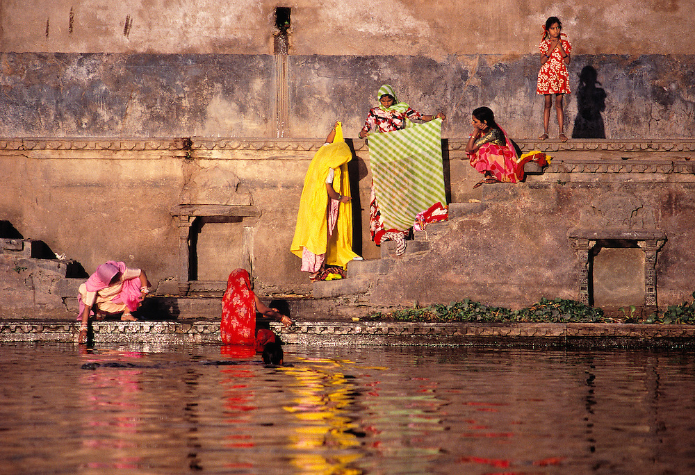 Bathers share early morning gossip on Lake Pichola in Udaipur, Rajasthan, India.