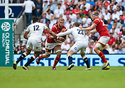 Wales' Ross Moriarty runs at England's Elliot Daley and Luther Burrell during the The Old Mutual Wealth Cup match England -V- Wales at Twickenham Stadium, London, Greater London, England on Sunday, May 29, 2016. (Steve Flynn/Image of Sport)
