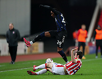 Middlesbrough's Djed Spence is tackled by Stoke City's Morgan Fox<br /> <br /> Photographer Alex Dodd/CameraSport<br /> <br /> The EFL Sky Bet Championship - Stoke City v Middlesbrough - Saturday 5th December 2020 - bet365 Stadium - Stoke-on-Trent<br /> <br /> World Copyright © 2020 CameraSport. All rights reserved. 43 Linden Ave. Countesthorpe. Leicester. England. LE8 5PG - Tel: +44 (0) 116 277 4147 - admin@camerasport.com - www.camerasport.com