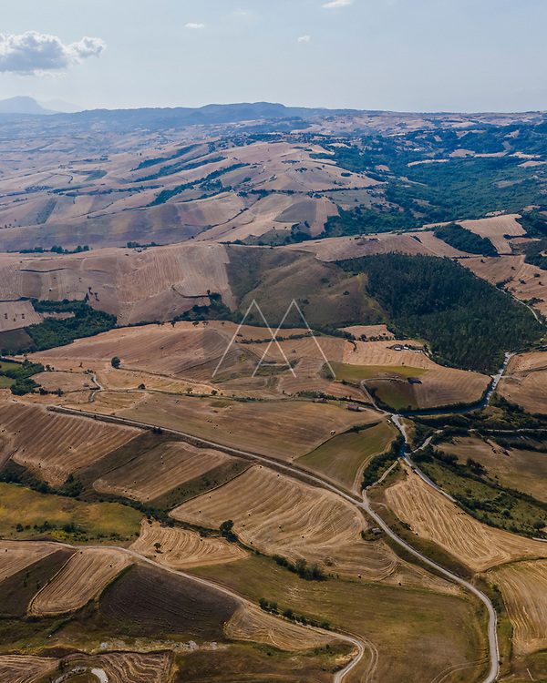 Aerial view of Irpinia countryside near Cairano with agricultural field and small roads, Irpinia, Avellino, Italy.