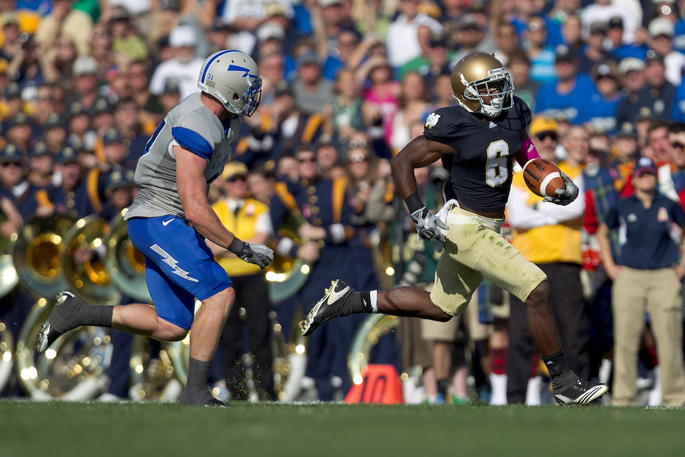 Notre Dame wide receiver Theo Riddick (#6) runs for yardage after catch in action during NCAA football game between Notre Dame and Air Force.  The Notre Dame Fighting Irish defeated the Air Force Falcons 59-33 in game at Notre Dame Stadium in South Bend, Indiana.