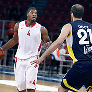 Olimpiakos's Kyle HINES (L) during their Two Nations Cup basketball match Fenerbahce Ulker between Olimpiakos at Abdi Ipekci Arena in Istanbul Turkey on Saturday 01 October 2011. Photo by TURKPIX
