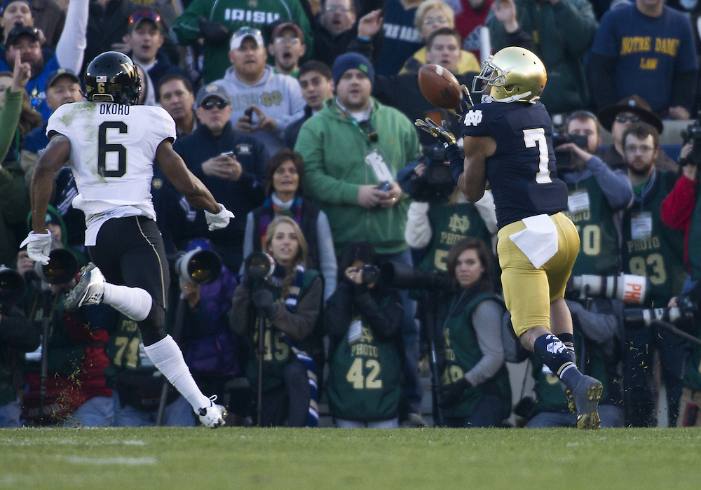 November 17, 2012:  Notre Dame wide receiver TJ Jones (7) catches touchdown pass as Wake Forest cornerback Chibuikem Okoro (6) defends during NCAA Football game action between the Notre Dame Fighting Irish and the Wake Forest Demon Deacons at Notre Dame Stadium in South Bend, Indiana.  Notre Dame defeated Wake Forest 38-0.
