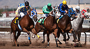 """© Steven St. John / The Communicator..Jude Baca, left, pushes his horse """"He's A Slinky"""" past the competition during his race The Downs at Albuquerque on Friday, Sept. 2, 2011....."""