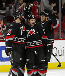 March 3, 2017 - Raleigh, NC, USA - The Canes Lee Stempniak (21) celebrates his goal with Jaccob Slavin (74) and Jay McClement (18) during the first period of an NHL game played between the Carolina Hurricanes and the Arizona Coyotes at PNC Arena on March 3, 2017 in Raleigh, N.C. (Credit Image: © Chris Seward/TNS via ZUMA Wire)