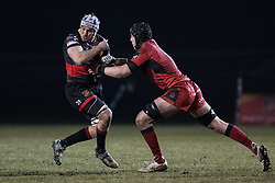 Dragons' Ollie Griffiths holds onto the ball despite the attentions of Edinburghs' Lewis Carmichael.<br /> <br /> Photographer Simon Latham/Replay Images<br /> <br /> Guinness PRO14 - Dragons v Edinburgh - Friday 23rd February 2018 - Eugene Cross Park - Ebbw Vale<br /> <br /> World Copyright © Replay Images . All rights reserved. info@replayimages.co.uk - http://replayimages.co.uk