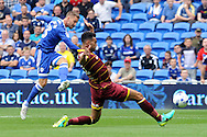 QPR's Steven Caulker ® blocks Cardiff City's Anthony Pilkington's shot. EFL Skybet championship match, Cardiff city v Queens Park Rangers at the Cardiff city stadium in Cardiff, South Wales on Sunday 14th August 2016.<br /> pic by Carl Robertson, Andrew Orchard sports photography.