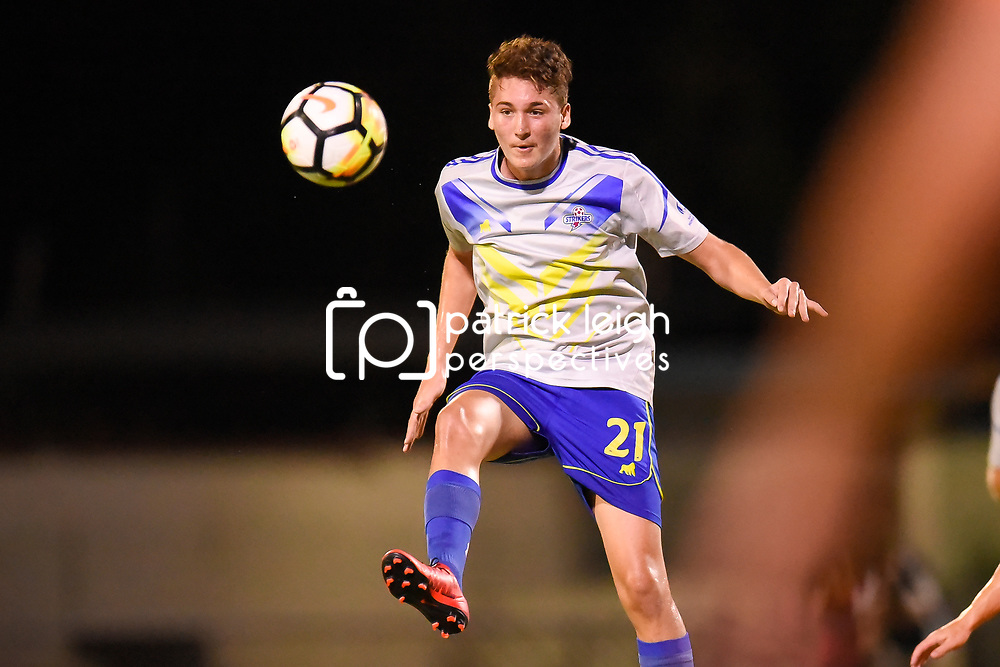 BRISBANE, AUSTRALIA - JANUARY 27: Sebastian Scaroni of the Strikers heads the ball during the Kappa Silver Boot Grand Final match between Lions FC and Brisbane Strikers on January 27, 2018 in Brisbane, Australia. (Photo by Patrick Kearney)