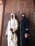 Models in traditional dress, Fortified city of Ait Benhaddou, Atlas Mountains, Morocco