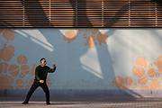A man exercises with Taichi at Fuxing Park in Shanghai, China, on Feb. 6, 2016.