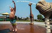 Kody Tarantino, 6, plays with the water features at Deer-Okamoto Park in Elk Grove, Wednesday, August 8, 2018.