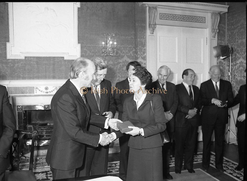 New Government Receive Seals Of Office.   (N84)..1981..30.06.1981..06.30.1981..30th June 1981..The newly elected Fine Gael /Labour coalition government under Dr Garret Fitzgerald received their seals of office from President Hillery at Áras an Uachtaráin today...Image shows Ms Eileen Desmond TD being presented with her seal of office as Minister of Health and Social Welfare from President Patrick Hillery.