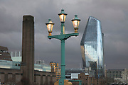 New skyscraper One Blackfriars Bridge, an old cast iron street lamp, and the old chimney tower of Tate Modern on the Southern skyline of London, England, United Kingdom. 1 Blackfriars or One Blackfriars, is a development at Bankside, London. The development is a 52-storey 170m tower and two smaller buildings of 6 and 4 stories respectively. Uses include residential flats, a hotel and retail.
