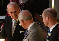 File photo dated 12/10/18 of the Duke of Edinburgh, the Prince of Wales and the Duke of Cambridge at the wedding of Princess Eugenie to Jack Brooksbank at St George's Chapel in Windsor Castle. The Duke of Edinburgh has died, Buckingham Palace has announced. Issue date: Friday April 9, 2020.
