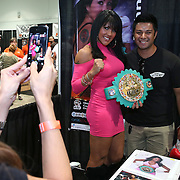 LAS VEGAS, NV - SEPTEMBER 13: Mia St. James poses with a fan during the Box Fan Expo at the Las Vegas Convention Center on September 13, 2014 in Las Vegas, Nevada.   (Photo by Alex Menendez/Getty Images) *** Local Caption ***Mia St. James