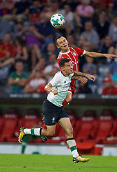MUNICH, GERMANY - Tuesday, August 1, 2017: Liverpool's Philippe Coutinho Correia and Bayern Munich's Rafinha during the Audi Cup 2017 match between FC Bayern Munich and Liverpool FC at the Allianz Arena. (Pic by David Rawcliffe/Propaganda)