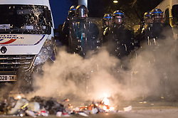 Riot police officers face protesters as people gather during a demonstration to show support to a 22-year-old youth worker, identified only as Theo, after he was assaulted on February 2, in Barbes Rochechouart district in Paris, on February 15, 2017. Photo by Eliot Blondet/ABACAPRESS.COM
