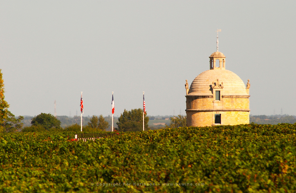"""Chateau Latour vineyard in Pauillac. This is the """"tower"""". The (not very big) chateau itself is a little bit further away. American, French and British flag"""