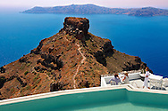Hotel terrace overlooking the volcanic plug  of Imerovigli, Santorini, Greece. .<br /> <br /> If you prefer to buy from our ALAMY PHOTO LIBRARY  Collection visit : https://www.alamy.com/portfolio/paul-williams-funkystock/santorini-greece.html<br /> <br /> Visit our PHOTO COLLECTIONS OF GREECE for more photos to download or buy as wall art prints https://funkystock.photoshelter.com/gallery-collection/Pictures-Images-of-Greece-Photos-of-Greek-Historic-Landmark-Sites/C0000w6e8OkknEb8