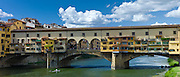 The Ponte Vecchio from the north side of the River Arno, Florence, Tuscany, Italy