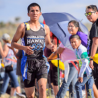 Laguna Acoma Hawk Colton Salvador closes in on the finish line to finish in third place during the Rehoboth Invitational cross country meet in Rehoboth Friday.