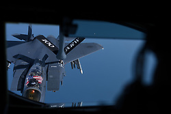 An F-15E Strike Eagle from RAF Lakenheath receives fuel from a KC-135 Stratotanker assigned to the 100th Air Refueling Wing from RAF Mildenhall over England, July 19, 2018. The F-15E was one of four to receive fuel during a routine training mission. (U.S. Air Force photo by Senior Airman Alexandra West)