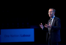 © London News Pictures. 23/09/2013 . Brighton, UK.   Shadow Secretary of State for Defence JIM MURPHY speaking on stage on day two of the Labour Party Annual Conference in Brighton. Photo credit : Ben Cawthra/LNP