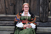 A woman dressed up in historical costume at the Norsk Folkemuseum on 28th August 2016 in Oslo, Norway. The Norwegian Museum of Cultural History, at Bygdoy, Oslo, is a museum of cultural history with extensive collections of artifacts from all social groups and all regions of the country.
